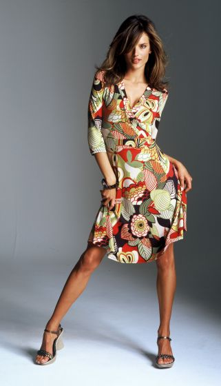 The bold all over energetic print flattering wrap dress