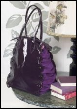 Plumo purple patent and suede handbag