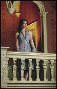 Emma Somerset Autumn/Winter 2007 silver grey silk halter neck dress and scarf �440 by Jovani. Earrings �55 by Emma Somerset.