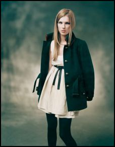 Topshop - Cream chiffon empire line dress with black tie �40/�60. Black military piped coat �80/�120, black opaque tights �6/�9.