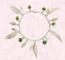 Curteis Jewellery 2007 contemporary style sterling silver ladies feather charm bracelet.from the 'feathers' collection within the 'inspired' jewellery range by Curteis Ltd. Semi precious beads comprise: Olivine Swarovski crystal. RRP: £70.