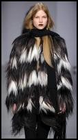 Jaeger fur jacket with black and white piecing.  Jaeger Long Hair Shearing Coat - Product 700026.  Jaeger Ribbed Scarf with Long Fringe - Product 620044 and available at Jaeger.