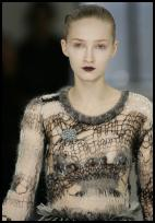 Rodarte knitwear with spider's cobweb effects of random lacy structure.