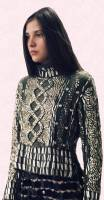 This spectacular metallic cable knit jumper embedded with sequins has the look of armour. The sweater is from Christopher Kane and achieves breathtaking designer mastery.