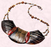 Wooden plate necklace on beaded rope - �10 - Boho Tech Freedom at Topshop .