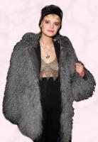 Pixie Geldof wearing a dyed Mongolian fur chubby coat.