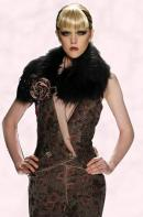 Catwalk fashion design with rose corsage and from fashion house Venexiana.