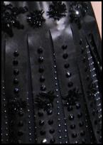 Detail of stud decoration on Prada Roman legion dress - Autumn 2009 Fashion on fashion-era.com.