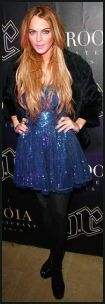 Lindsay Lohan wearing a blue sequin dress.