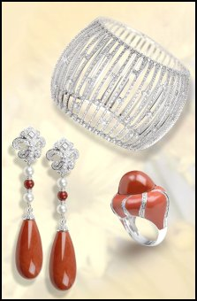 Jewels of Ocean on fashion-era. Diamond cuff and rich coral ring and earrings with diamonds.