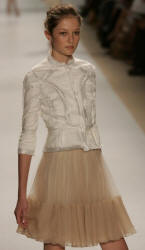 White karakul jacket with satin trim by J Mendel