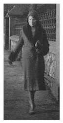 Gwen wears a wrap coat of 1931