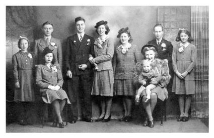 1940s Wedding - Old wedding photo featuring wartime utility suits in 1945