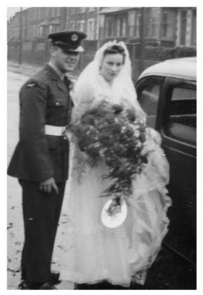 Dawn and Bryn Jenkins on their rainy 1954 wedding day.