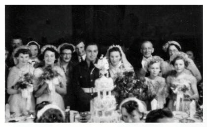 The ornate wedding cake and the bridal group 1954.