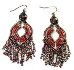 Eye-catching bronze coloured drop earrings decorated with chains and lots of tiny iridescent red beads