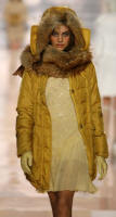 BLUGIRL- Yellow silk parka with fox trim.