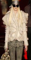 White toscana jacket with fox trim from John Galliano at Dior