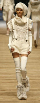 DOLCE & GABBANA Collection - Fox boots, cream hot pants, braces, knitwear and hat.