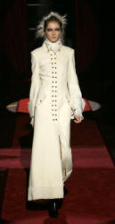 Ferre white double-breasted maxi coat with karakul cuffs.