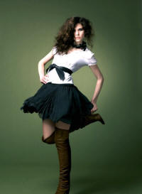 White short sleeved blouse �25 with Puff ball skirt �28. Colours available: Black and pink. Leather tie sash �18.