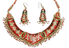 Red toned enamel Indian fashion jewellery necklace and earrings from Venkatraman Jewels of Jaipur India.