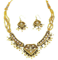 Gold toned beautiful Indian fashion jewellery necklace and earrings from Venkatraman Jewels of Jaipur India.