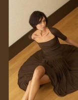 This dark brown dress is by Graeme Black and could be styled in variety of ways to make it look different