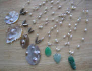 Mother of pearl pendant and jade carved pendants with pearl wires