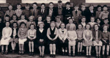 Picture of Gwyndy Junior School children circa 1957-8. Costume history and fashion history 1950s.