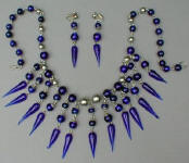 Fashion-era picture of costume jewellery blue glass bead pieces from Glitterbug
