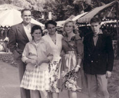 Picture of family at the fairground circa 1959. Costume history and fashion history 1950s.