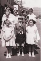 Picture of Whitsunday Family and Friends Group. Costume history and fashion history 1950s.