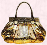 Zagliani materials are silicon injection treated and this lovely gold crocodile handbag retails at approx �1500.