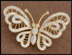 Heavenly treasures - The fine jewellery butterfly brooch pin left has a different effect when diamonds are set against yellow gold
