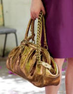 This gold bag is from The House Fraser and their new range called Untold.