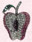 Affordable Mikey apple brooch.