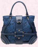 Blue suede and perforated leather butterfly bag is by Alexander McQueen. This bag is available from Browns Fashion of South Molton Street, London, UK or their online site at £1015