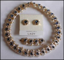 Propert of a Lady choker necklace with extender for lengthening and earrings in Swarovski crystal.