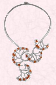 Van Cleef & Arpels Castalie neckpiece. The Castalie Necklace is set in White gold to enhance round diamonds and orange, gold, mandarin garnets.