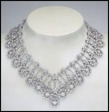 The Van Cleef & Arpels diamond Organdi Couture collection necklace left is made of white gold and diamonds (79.18 carats) and the piece makes an outstanding item of jewellery.