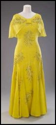 The Queen's yellow cape evening dress of 1974 was designed by Ian Thomas