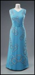 The Queen's Turquoise blue evening dress worn on the tour of Canada,1976 and during the Montreal Olympics. The dress was once again designed by Norman Hartnell.