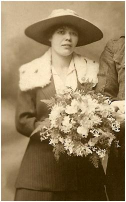 1919 bride wearing a suit.