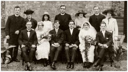 A 1921 Double Wedding in Hebburn. Front row centre left - Margaret Laydon, the first bride with her bridegroom James Aspinwall M.M. Next to him in formal dress is the second bridegroom Patrick Thomas Rowan, who married bride Maria Laydon far right.