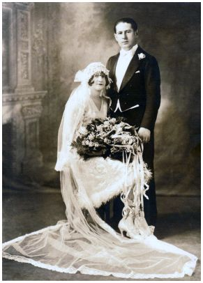 Fashion-era wedding c1928 - Bride in full veil and short wedding dress.