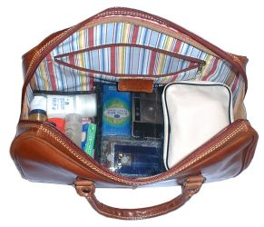 Layer The Toiletry Bags At Base Of Floto Venezia Bag And Then Add Clothes