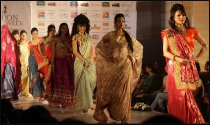Vibrant Fashion Week Red and Gold Indian Saris