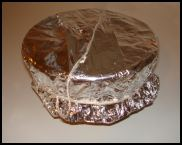 Xmas Pudding foil and paper on basin tightly secured with string